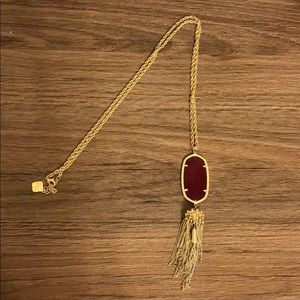 Long, gold KS Rayne necklace with maroon stone